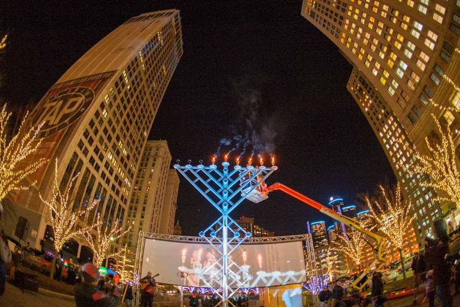 Menorah in the D celebrated a decade of celebrating Hanukkah in downtown Detroit with a large menorah. Downtown Detroit has no large Kwanzaa kinara. - COURTESY OF MENORAH IN THE D