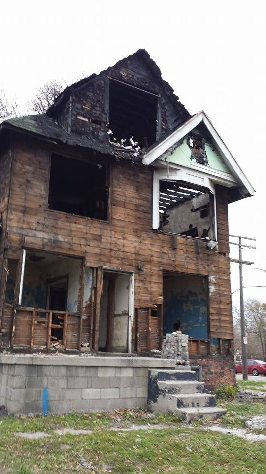 This was the blighted, fire-ravaged house before it was torn down.