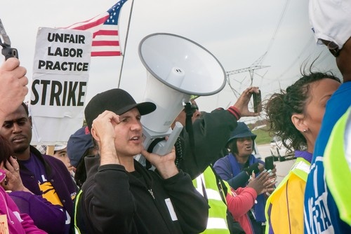 Striking workers and supporters from an Illinois Walmart distribution center march against unfair labor practices, including wage theft, in 2012. - IMAGE COURTESY SHUTTERSTOCK