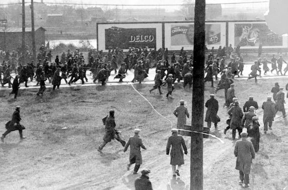 Demonstrators on Miller Road outside of the Rouge Plant flee as tear gas and bullets are released on them by Dearborn Police and Ford Servicemen during the 1932 Ford Hunger March. - PHOTO COURTESY WALTER REUTHER LIBRARY, WAYNE STATE UNIVERSITY