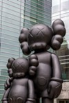 """Waiting,"" statue by artist KAWS."