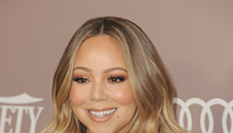 Mariah Carey's Twitter was hacked on New Year's Eve, claims Eminem has a small penis