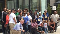 Group of mostly black Detroiters takes photo at site of controversial Bedrock ad