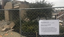 Scathing sign lampoons DIA's Barat House demolition