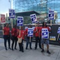 Workers on strike outside of GM's Detroit headquarters.