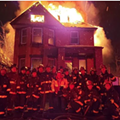Detroit firefighters may face discipline after posing in front of burning house