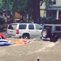Watch: Jeep tows tubers down flooded Ann Arbor street