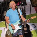 Review: Jimmy Buffett brings hits, beach balls, surprise deep cuts in return to Clarkston