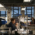 Employees at Shinola's New Center leather factory, located in a former GM design lab.