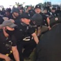 Detroit Police kneeled for the cameras minutes after arresting about 100 peaceful protesters