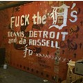 Anti-Dennis Kefallinos graffiti scrawled across a mural at the Russell Industrial Center