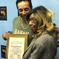 Aretha Franklin surprises Smokey Robinson with City of Detroit award before Chene Park show