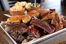 ROB WIDDIS - The 6 Pack, with brisket, chicken, pulled pork, zekewurst, ribs, burnt ends and cornbread, from Zeke's Rock 'n' Roll BBQ in Ferndale.