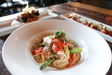 SCOTT SPELLMAN - Lobster spaghetti, with - sautéed garlic, tomatoes, chopped asparagus, and lobster atop thin spaghetti, from the Stand in Birmingham.