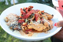 PHOTO BY SCOTT SPELLMAN. - Pollo Sambuca with oven-roasted Herb tomato quinoa pilaf.