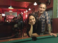PHOTO BY JAMIN TOWNSLEY. - Tia and Brian Krawczyk in Bumbo's, the neighborhood bar they've given a quirky update.
