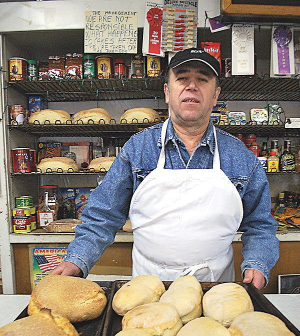 Vasile Sirca shows off his bakery's breads.
