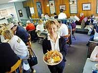 Whistle Stop Restaurant: Waitress Elizabeth Kearns serves a cheeseburger and fries - METRO TIMES PHOTO / LARRY KAPLAN