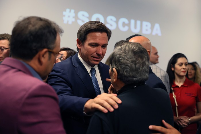 Florida Gov. Ron DeSantis greets people after holding a roundtable discussion about the uprising in Cuba at the American Museum of the Cuba Diaspora on July 13, 2021, in Miami. - PHOTO BY JOE RAEDLE/GETTY IMAGES