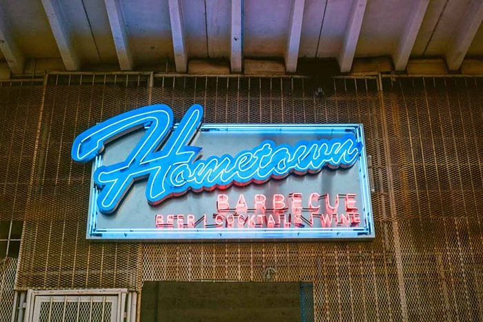 Hometown Barbecue's sign welcomes you in for a good meal. - PHOTO BY DANIEL KRIEGER