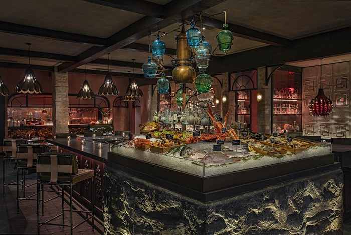 The tequila tree dispenses mezcal and tequila at the bar inside Moxy Miami South Beach's new seafood restaurant Como Como. - PHOTO BY MICHAEL KLEINBERG