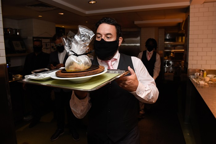 A chef serves dinner at the Bazaar by José Andrés. - PHOTO BY MICHELE EVE SANDBERG