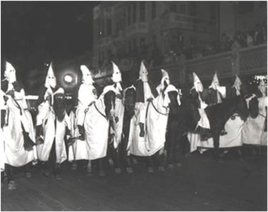 The Ku Klux Klan prepares to ride through Downtown Miami circa the 1940s. - PHOTO COURTESY OF MARVIN DUNN