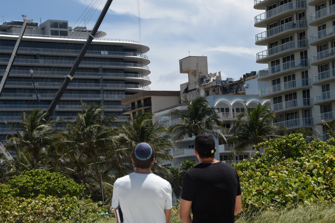 Onlookers on Surfside Breach watch the broken remains of the Champlain Towers South condo before it was torn down this past Sunday.