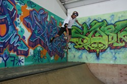 PHOTO BY KEN WEIDERMAN - 16-year-old Kacey Soares foot-plants above the mini ramp at RampArt.
