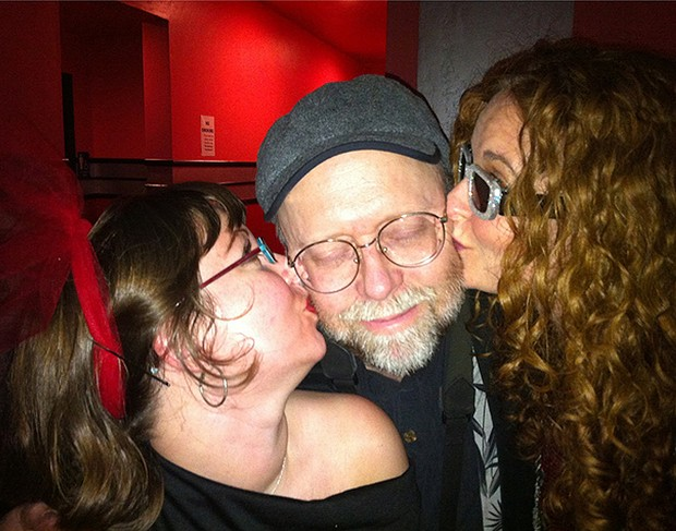 A blissful Kevin Hoover smootched by a pair of Eye Dolls - PHOTO BY BOB DORAN