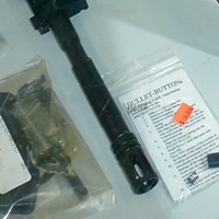 Can We Ban Assault Guns? A bullet button for sale at a local gun retailer. © north coast journal