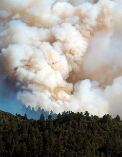 PHOTO COURTESY OF KIM SALLAWAY - A CalFire helicopter surveys the scene of the Lodge Complex Fire on Aug. 8. Started by a lightning strike on July 30, the fire had spread to 10,700 acres, threatening 58 structures, as of Aug. 13.