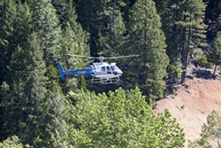 PHOTO BY PRESTON DRAKE HILLYARD - A CHP helicopter searches for Sophia.
