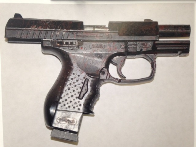 A police photograph of the replica handgun reportedly found on McClain. - THADEUS GREENSON