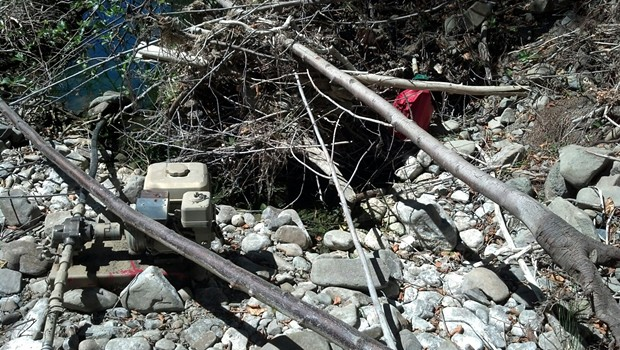 A pump drains Mattole Canyon Creek to water marijuana crops. - HUMBOLDT COUNTY SHERIFF'S OFFICE