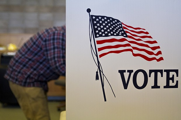 A registered voter fills out a ballot at Arcata City Hall. - MANUEL J. ORBEGOZO