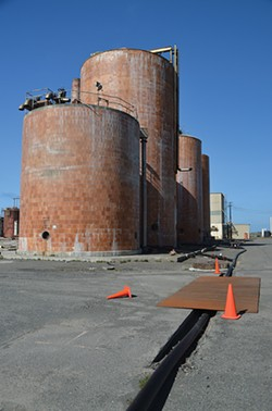 PHOTO BY GRANT SCOTT-GOFORTH - A serene and decaying industrial landscape. These tanks will be demolished when pulping liquors are finally removed.