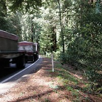 "A truck barely stays inside the line while rounding the curve between mile post markers 1.35 and 1.40. The area on the right is where Caltrans proposes a ""sliver fill.""  Photo by David Bergin."