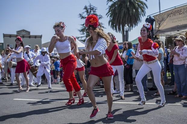 Afro-Cuban dancers cutting a rug at the parade. - ALEXANDER WOODARD