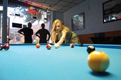 Alanna uses a public, less expensive P&J Billiards cue at P&J Billiards. - PHOTO BY ANDREW GOFF