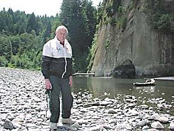 Albert Miller shows off a favorite swimming hole on the Van Duzen -- Swimmers' Delight in the county park. Photo by Barbara Clark/Senior News.