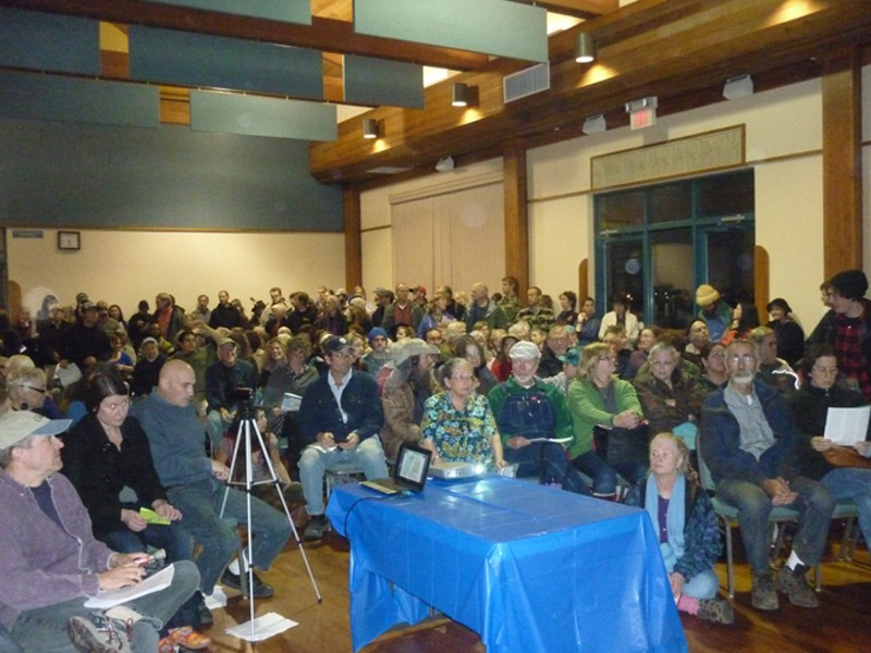 An uneasy crowd filled the Wharfinger Building last Wednesday for a Navy presentation on its expanded training exercises. - BY KEITH EASTHOUSE