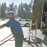 No Work? No Workers! Andrzei Lopag, at least, is happy to have a good job in America. Photo courtesy Humboldt Moving & Storage.