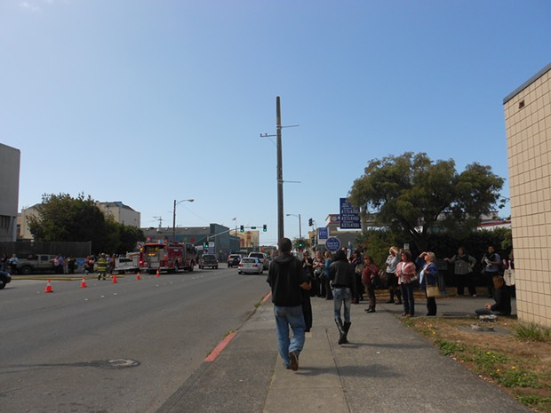 Courthouse employees watch the fire crew. - LINDA STANSBERRY
