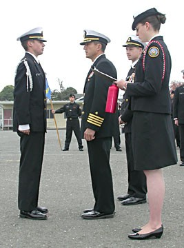 Area Manager Capt. Dan Wenceslao (retired), center, inspects cadets. Photo by Ryan Burns.
