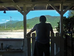 PHOTO BY SCOTTIE LEE MEYERS - Arthur Jones stands on the front porch of his home, where law enforcement found methamphetamine and cash after he was arrested in late 2011.