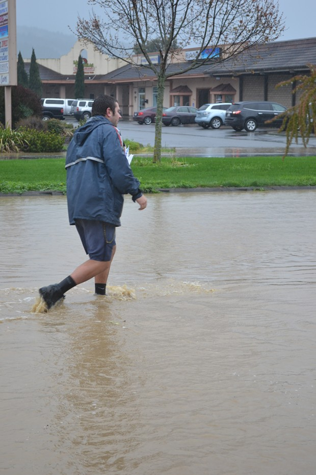As postal carrier Brad Renner's socks can attest, there's some localized urban flooding in Fortuna. - MELISSA SANDERSON