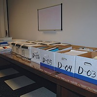 Taking on City Hall At one point, post-lawsuit, the city filled a room at City Hall with boxes for Egger to peruse. Photo by S.K. Campbell