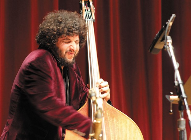 Bassist Omer Avital takes a solo while leading a vibrant quintet presented in concert by the Redwood Jazz Alliance in HSU's Fulkerson Hall on feb. 25. - PHOTO BY BOB DORAN