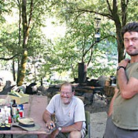 Rock and a Hard Place — Independent gold miners fear extinction as a new wave hits the hills Bill and Chad Stanford relaxing in camp at their North Fork Salmon River claim. Photo by Heidi Walters